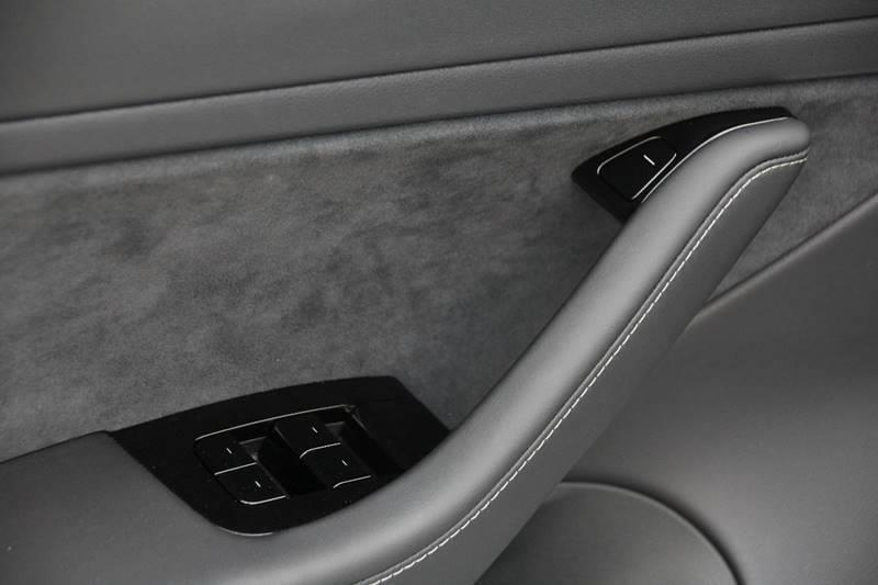 manual door release tesla model 3
